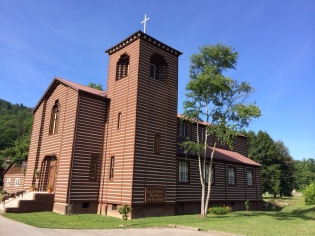 Harvey Murdoch built this log cathedral in 1907, where he served as pastor till his 1935 death.