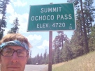 Second-to-last pass of my trip. It was hot, and a tough climb through burnt forest. Helmet off, bandana on.