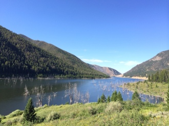 In 1959, a 7.5 magnitude earthquake triggered a mountain slide, damming the Madison river overnight and forming this lake. Twenty-eight people were killed. Most of them camping. You can still see the tops of trees sticking up.